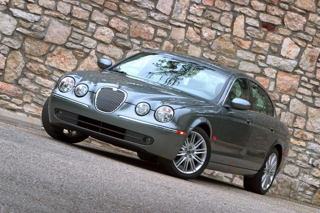 Jaguar S-Type 2005 grey stone wall : Stock Photo
