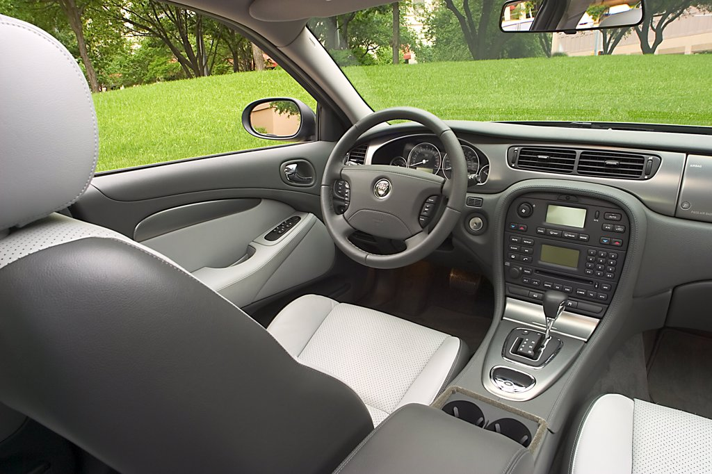 interior Jaguar S-Type 2005 steering wheel dashboard grey leather seats gear lever silver trim controls buttons center console : Stock Photo