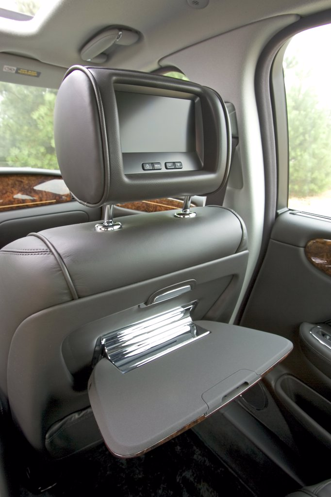interior detail 2006 Jaguar XJ8 Super V8 dvd screen tray grey leather : Stock Photo