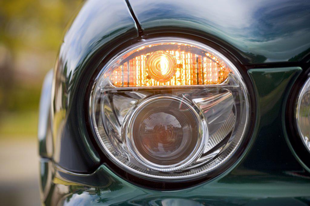 detail of a headlight light on a XJ R Jaguar : Stock Photo