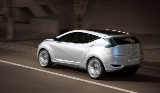 Stock Photo: 4093-6099 2009 Hyundai HCD-11 Nuvis Concept car driving through city, rear 7/8