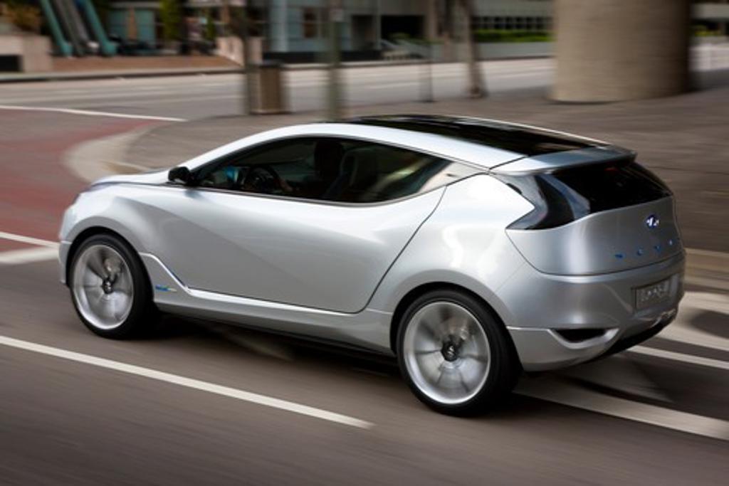 2009 Hyundai HCD-11 Nuvis Concept car driving through city, rear 7/8 : Stock Photo