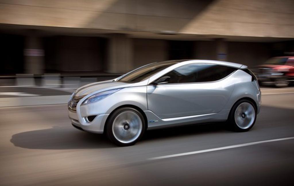 Stock Photo: 4093-6103 2009 Hyundai HCD-11 Nuvis Concept car driving through city, side view