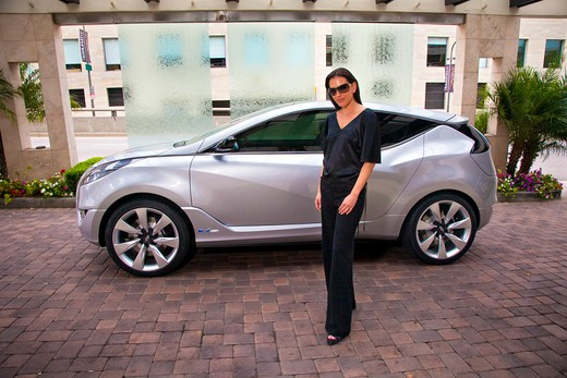2009 Hyundai HCD-11 Nuvis Concept car with lady owner, portrait : Stock Photo