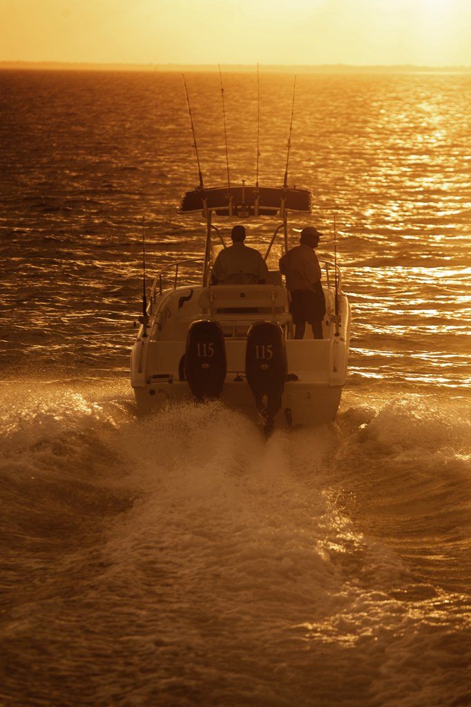 Coming back from offshore fishing before sunset Florida keys, MR:Y Winston Luzier Sea Chaser Tohatsu 115 TLDI : Stock Photo