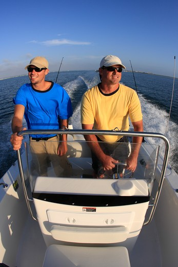 Stock Photo: 4093-6924 Friends / Guys going fishing on a Trophy 1703 Center Console boat. Pacific Ocean, near San Diego Harbor, CA.
