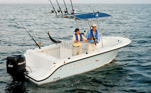 Stock Photo: 4093-6977 Friends / guys catching a tuna in their Trophy 2103 walkaround boat. Pacific Ocean near San Diego, CA.