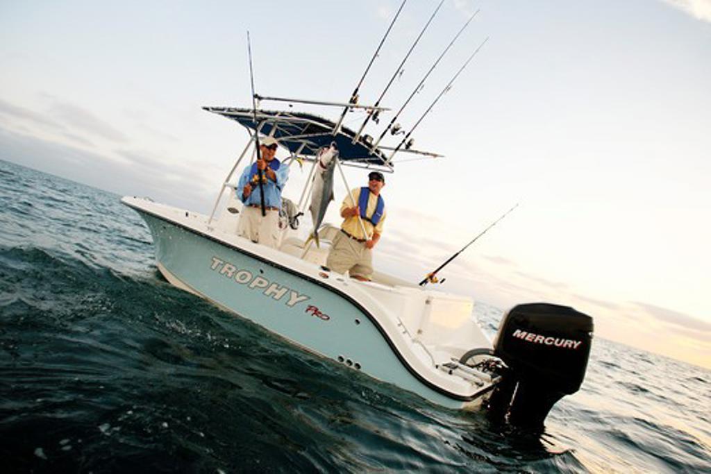 Stock Photo: 4093-6983 Friends / guys catching a tuna in their Trophy 2103 walkaround boat. Pacific Ocean near San Diego, CA.