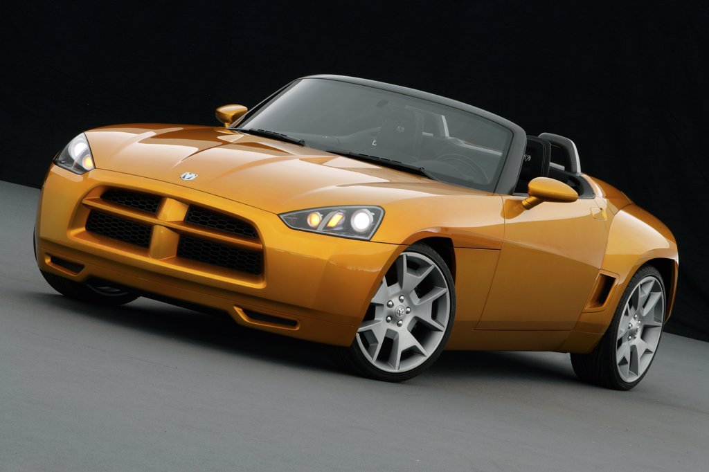 Stock Photo: 4093-8013 Front 3/4 view of a Dodge Demon Convertible concept. Gold color inside parked viewing with backdrop