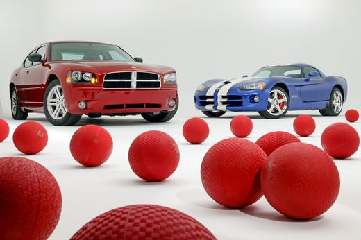2008 Dodge Charger RT in a studio with a 2008 Dodge Viper and a bunch of red rubber balls : Stock Photo