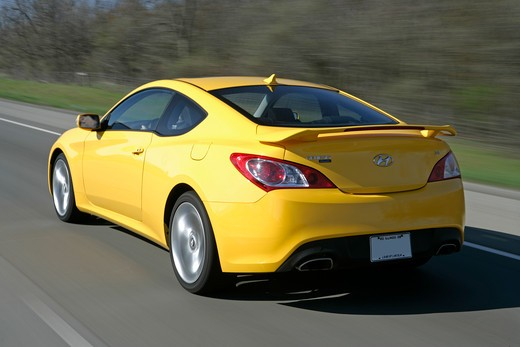 Stock Photo: 4093-8487 2010 Hyundai Genesis driving along road, rear view