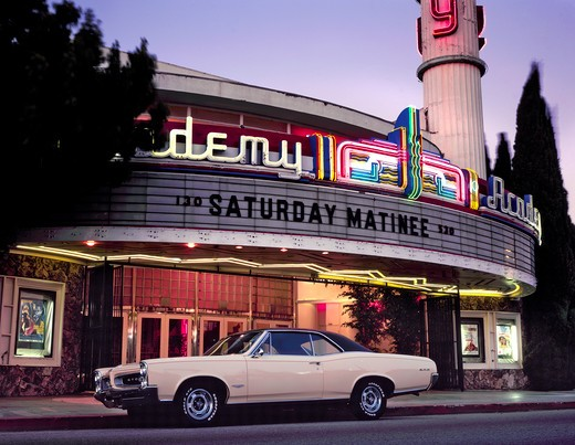 1966 Pontiac GTO white 1960s movie theater : Stock Photo