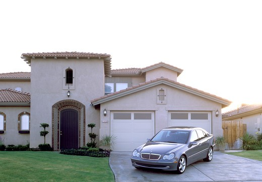 Mercedes Benz C230 C-Class 2004 grey driveway affluent city : Stock Photo