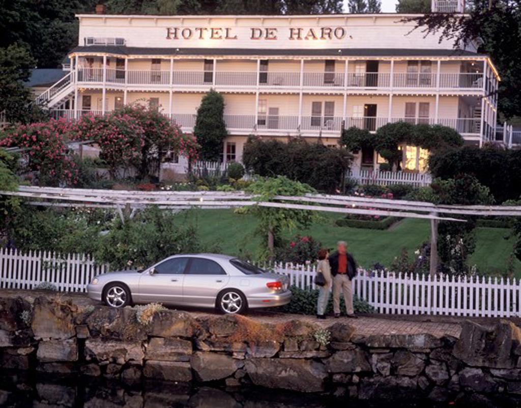 Mazda Millenia 2002 silver canal couple hotel garden street : Stock Photo
