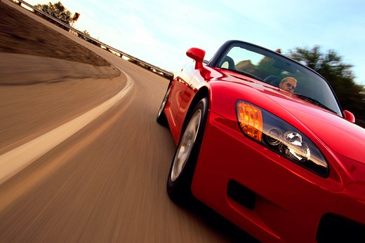 Honda S2000 2000 red detail front 3/4 nose headlight curve street : Stock Photo