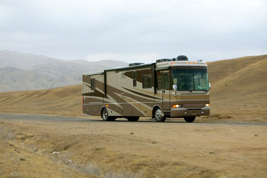2005 brown Fleetwood Providence RV. Driving on rural California road. : Stock Photo