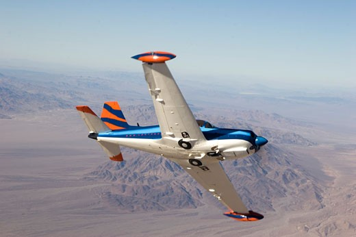 Marchetti SF-260 SF260 performing a break / wing-over. Over the deserts of Southern California. : Stock Photo
