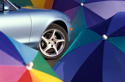 Mazda Miata 2001 blue beach umbrellas wheel : Stock Photo