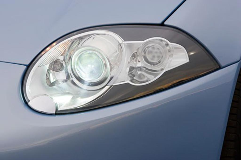 detail Jaguar Advanced Lightweight Coupe light blue headlight : Stock Photo