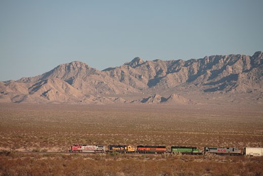 Stock Photo: 4093R-2251 BNSF freight train at Amboy California. in the distance pulled back view mountains and desert in the background