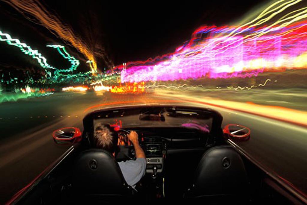 Stock Photo: 4093R-482 overhead interior Porsche 911 Carrera 4 2001 city lights street city