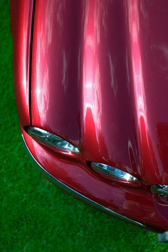 overhead high angle detail Jaguar X-Type 2005 red headlights hood : Stock Photo