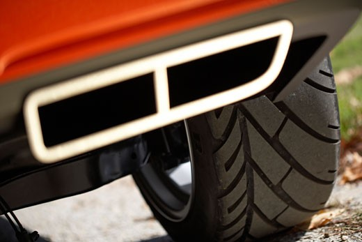 detail,2006 Dodge Challenger tire tread exhaust pipe : Stock Photo