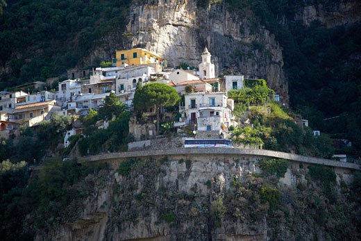 Town on the cliff with a coastal drive in front : Stock Photo
