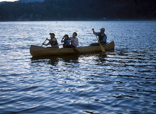 canoe family children kids paddling : Stock Photo