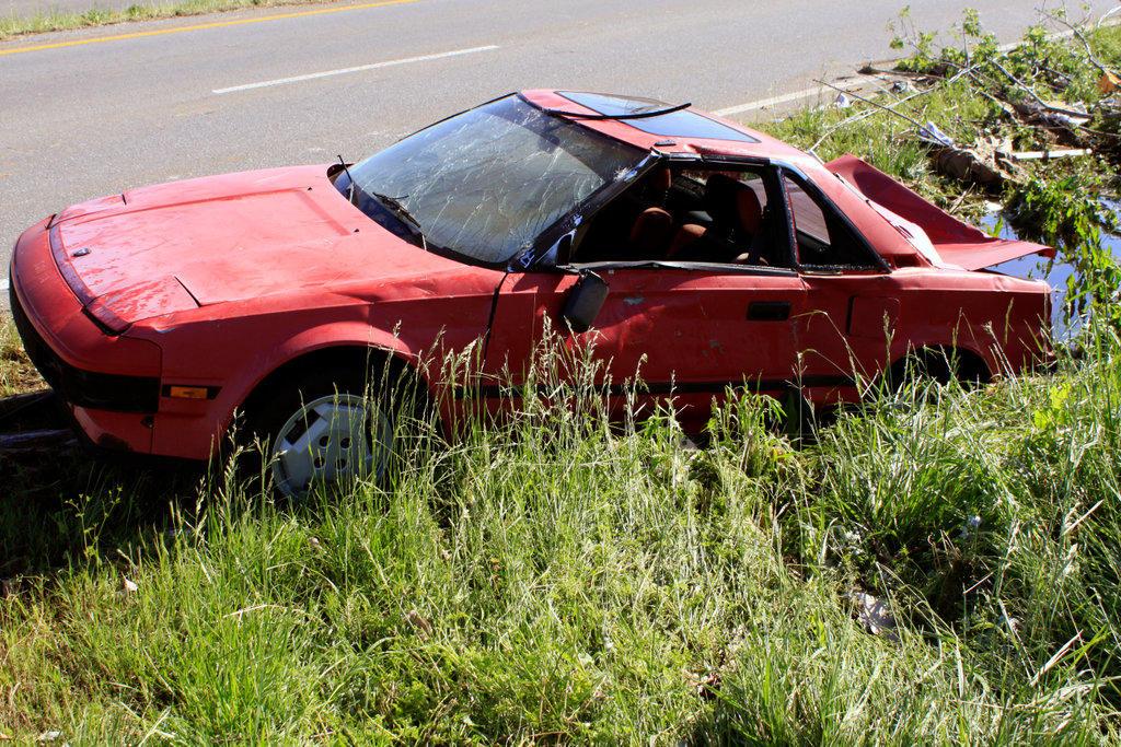 Damaged car at roadside after tornado ravaged, Limestone County, Alabama, USA : Stock Photo