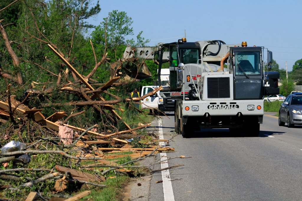 State highway crew cleaning debris from a road after a tornado, Alabama, USA : Stock Photo