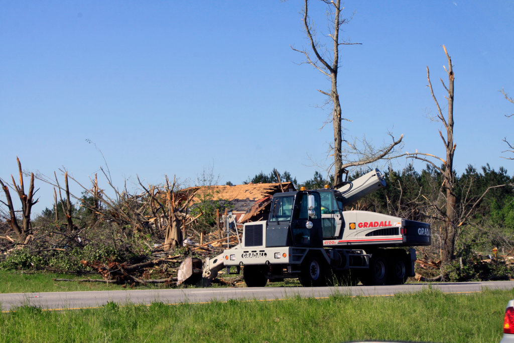 State highway crew cleaning debris from a road after a tornado, Limestone County, Alabama, USA : Stock Photo
