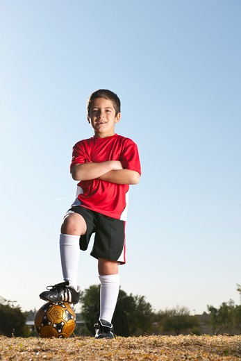 Stock Photo: 4096-117 Boy standing with a soccer ball