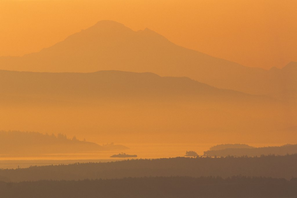 Stock Photo: 4097-1331A Mountain peak covered with fog at sunrise, Mt Baker, Haro Strait, Saanich Peninsula, Vancouver Island, British Columbia, Canada