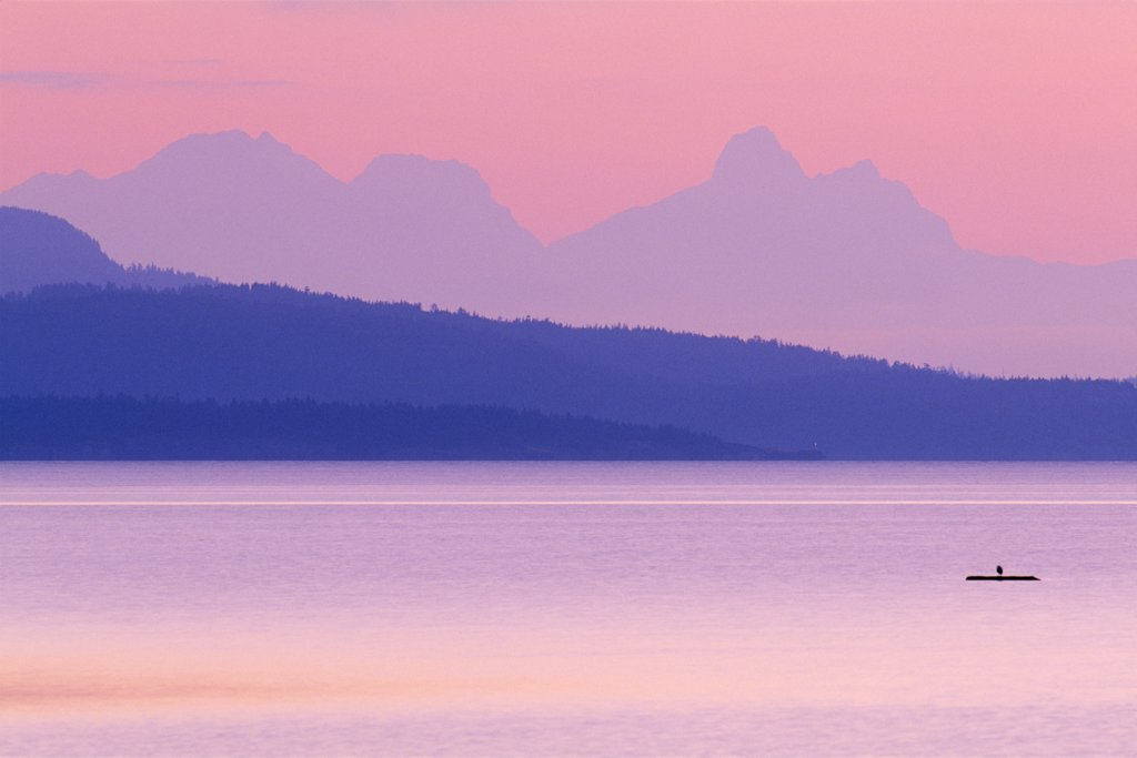 Stock Photo: 4097-1420 Silhouette of mountains at sunrise, Rathtrevor Beach Provincial Park, Parksville, Vancouver Island, British Columbia, Canada