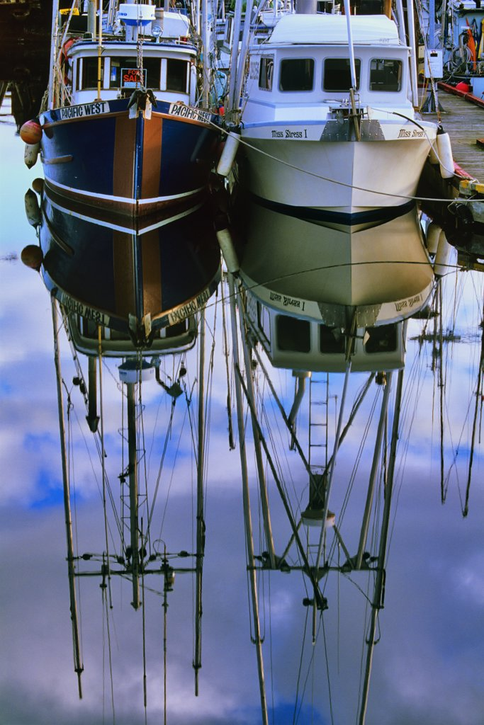 Stock Photo: 4097-1431 Reflection of fishing boats in water, French Creek, Vancouver Island, British Columbia, Canada
