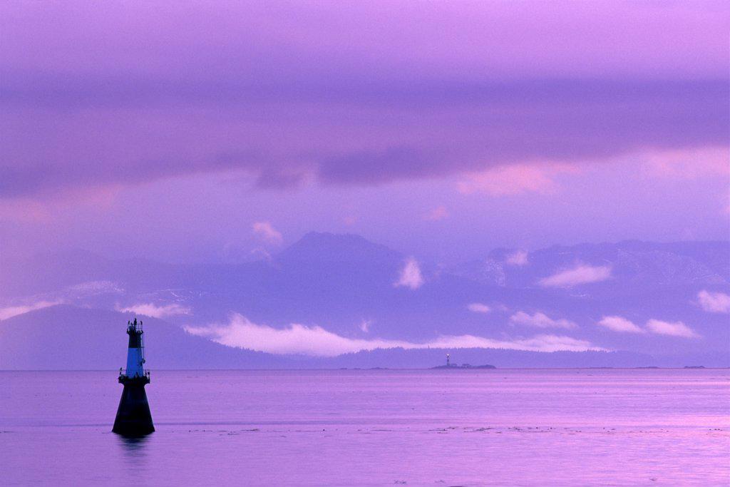 Silhouette of a navigational buoy in the sea, Strait of Juan De Fuca, Victoria, British Columbia, Canada : Stock Photo