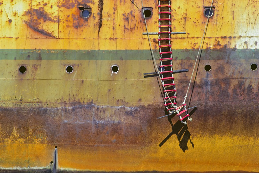 Stock Photo: 4097-202 Rope ladder hanging on a rusty container ship, Victoria, Vancouver Island, British Columbia, Canada