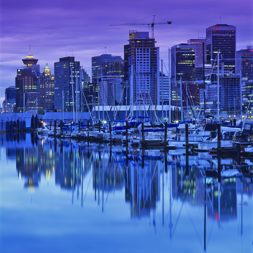 Stock Photo: 4097-2316 Skyscrapers in a city lit up at dusk, Coal Harbor, Vancouver, British Columbia, Canada