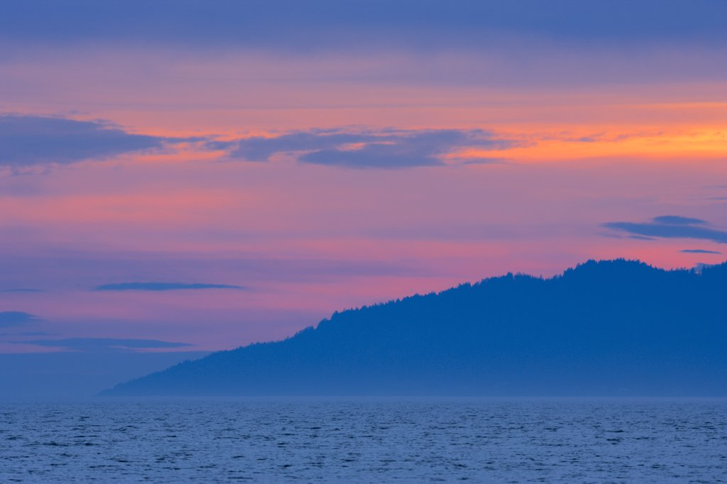Stock Photo: 4097-2339 Silhouette of an island at dusk, English Bay, Vancouver, British Columbia, Canada
