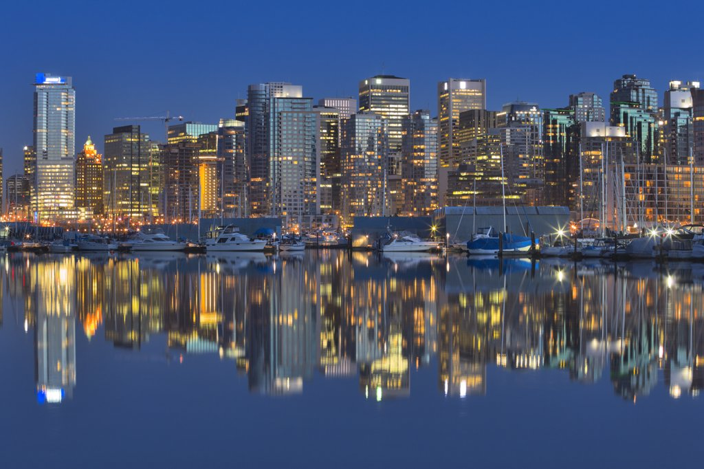 Stock Photo: 4097-2341 Skyscrapers in a city lit up at dusk, Coal Harbor, Vancouver, British Columbia, Canada