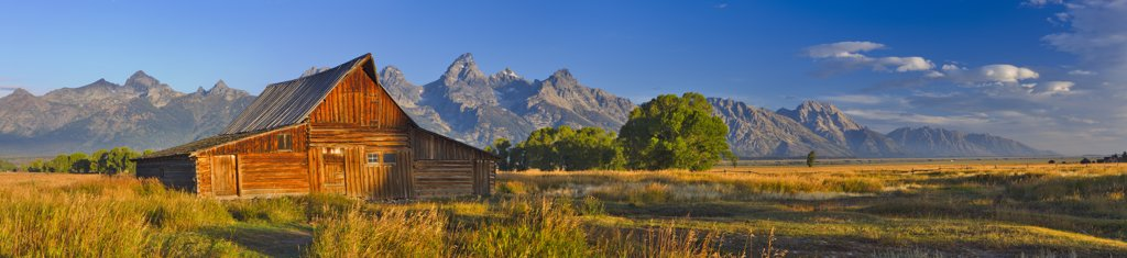 Stock Photo: 4097-3151 USA, Wyoming, Grand Teton National Park, T.A. Moulton Barn with mountains in background