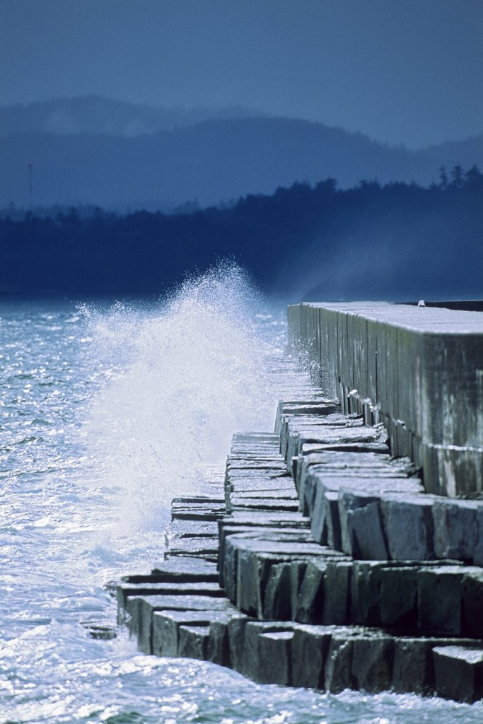 Waves breaking on the jetty, Ogden Point, Victoria, Vancouver Island, British Columbia, Canada : Stock Photo
