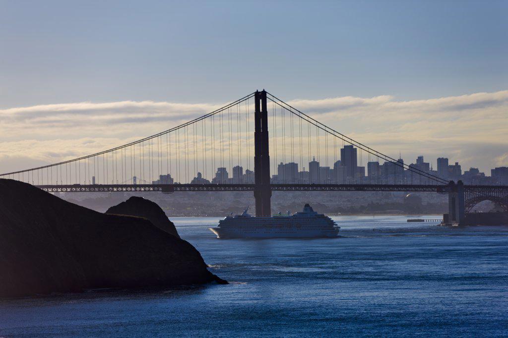 Stock Photo: 4097-3713 Suspension bridge across the bay with city skyline in the background, Golden Gate Bridge, San Francisco Bay, San Francisco, California, USA
