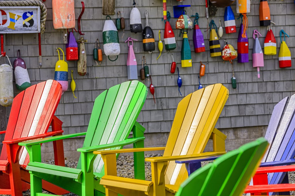 Stock Photo: 4097-3971 Adirondack chairs with buoys hanging on a wall, Blue Rocks, Nova Scotia, Canada