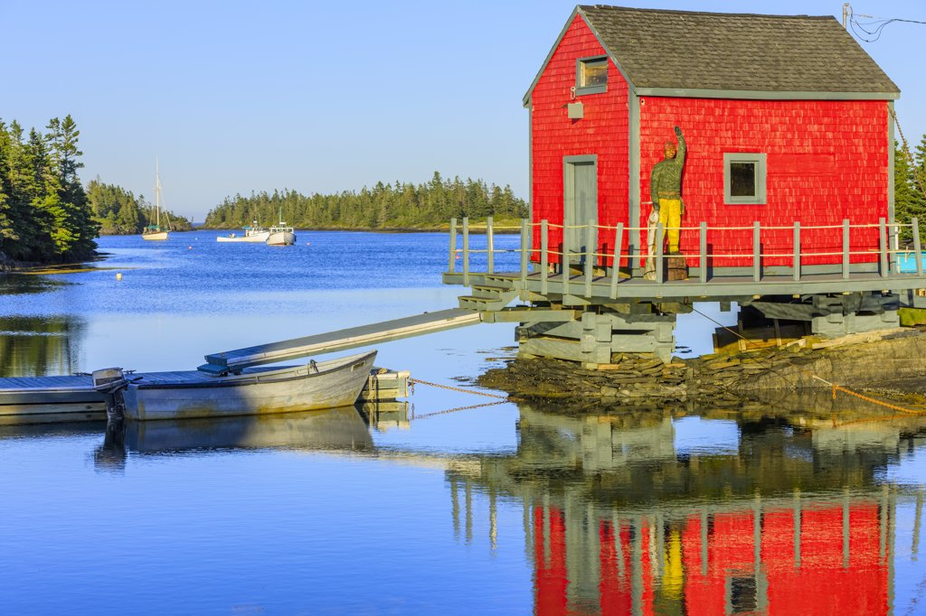 Reflection of a boat shed in water, Stonehurst East, Nova Scotia, Canada : Stock Photo