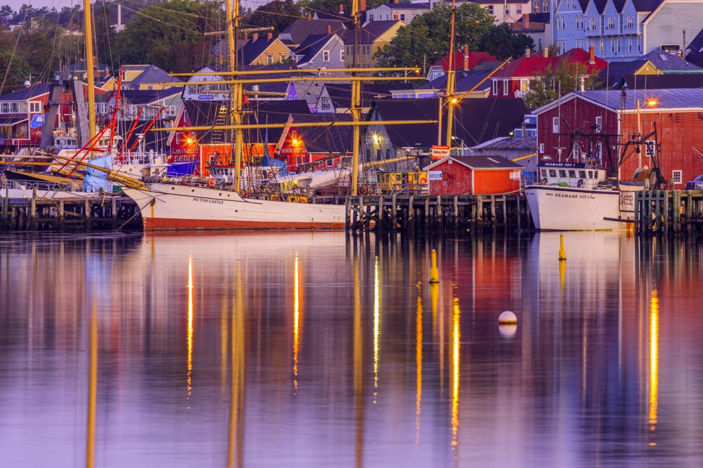 Reflection of boats and buildings in water, Lunenburg, Nova Scotia, Canada : Stock Photo