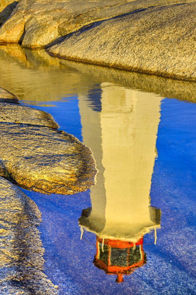 Reflection of a lighthouse in water, Peggy's Point Lighthouse, Peggy's Cove, St. Margarets Bay, Nova Scotia, Canada : Stock Photo