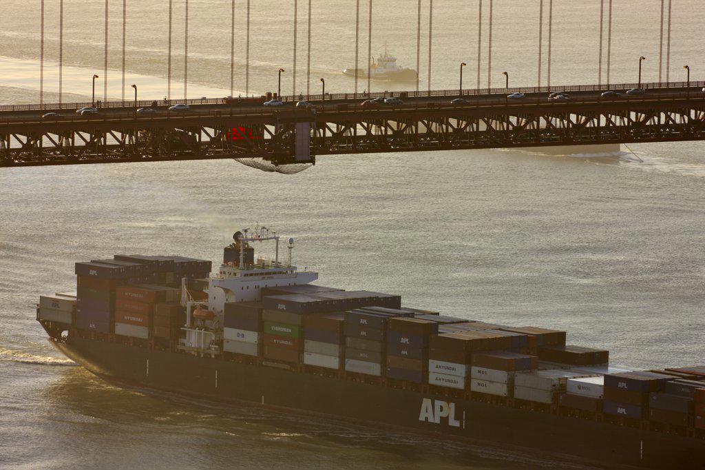 Stock Photo: 4097-529 Container ship passing under a bridge, Golden Gate Bridge, San Francisco Bay, San Francisco, California, USA