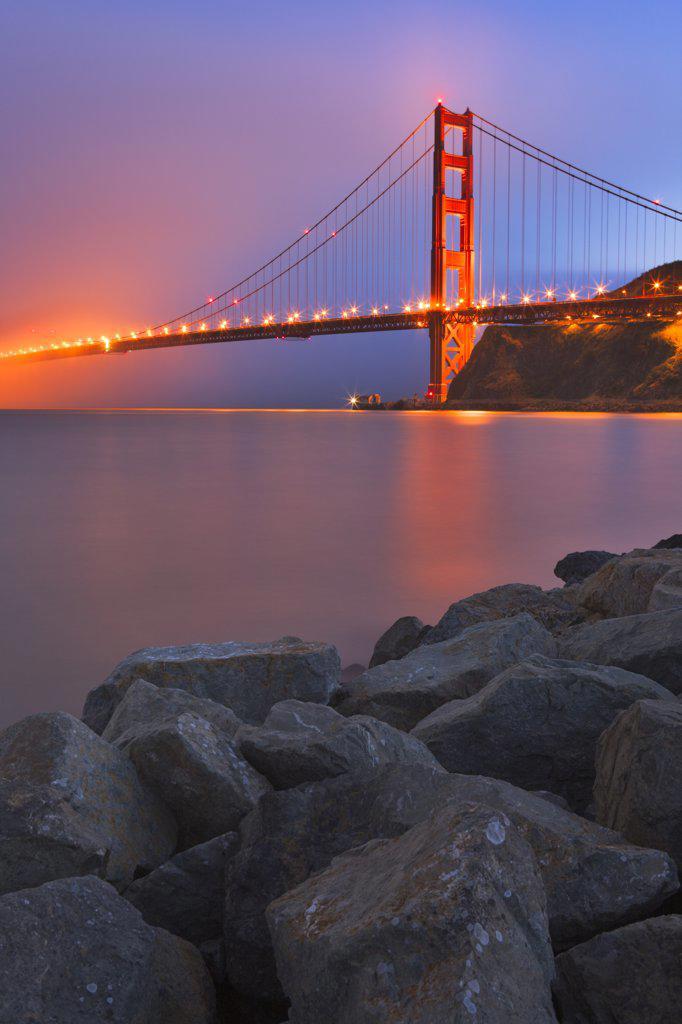 Stock Photo: 4097-555A Suspension bridge lit up at dusk, Golden Gate Bridge, San Francisco Bay, San Francisco, California, USA